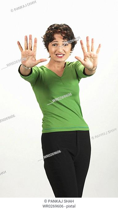 Lady Smiling with a Hand Gesture