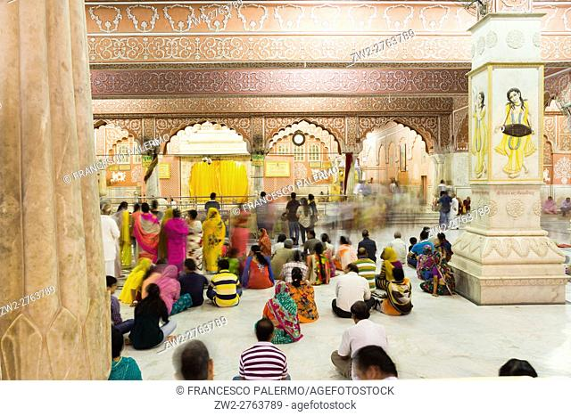Faithful in prayer to the god Krishna. Jaipur, Rajasthan, India