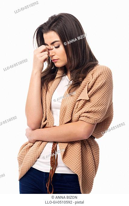 Worried young woman with sinusitis. Debica, Poland