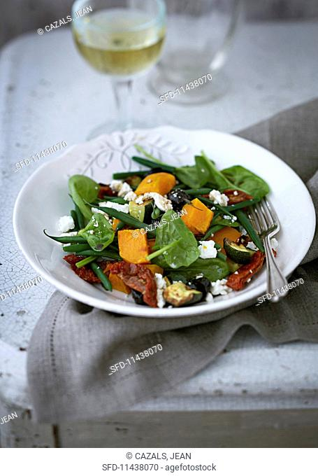 Vegetable salad with feta cheese and dried tomatoes