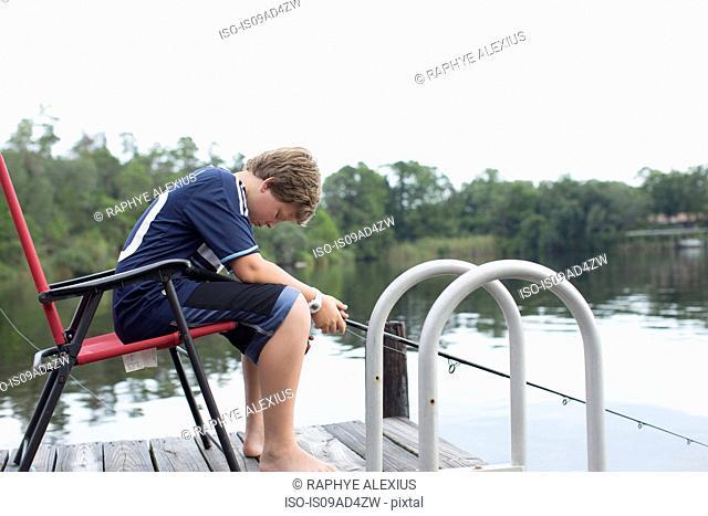 Portrait of boy fishing, Shalimar, Florida, USA