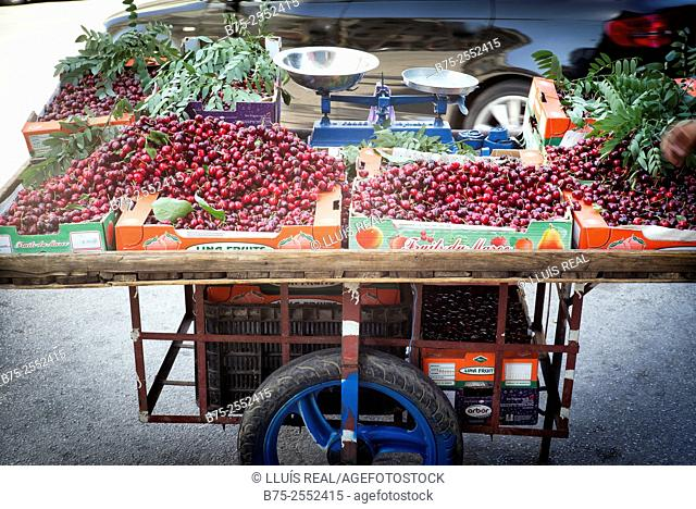 Street cart selling cherries. The Nouvelle Ville, Fes, Morocco, Africa