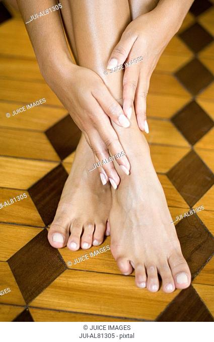 Close up of woman's hands and bare feet