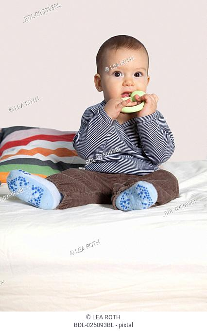 portrait of baby with teething ring