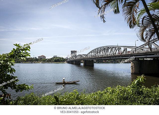 A little boat crossing bridge in Perfume river, Hue (Thua Thien-Hue province, Vietnam)