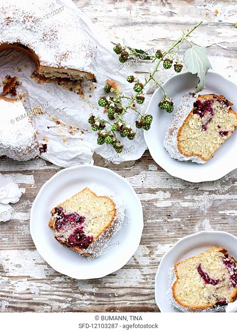 A sliced blackberry and coconut marble cake