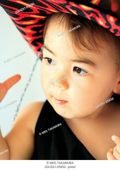 Close-up of a baby girl wearing a hat