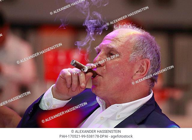 HANDOUT - Handout picture dated 20 May 2017 showing the President of the FC Bayern Munich, Uli Hoeness, smoking a cigar during the club's championship party at...