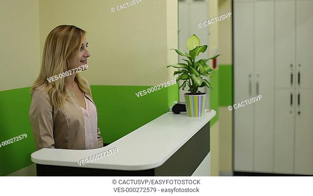 Female receptionist meeting client in beauty salon
