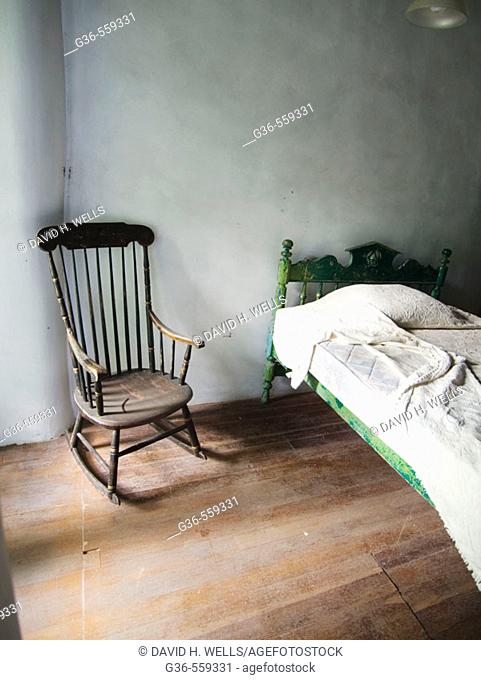 Bed and chair in a preserved 19th century home in New Mexico