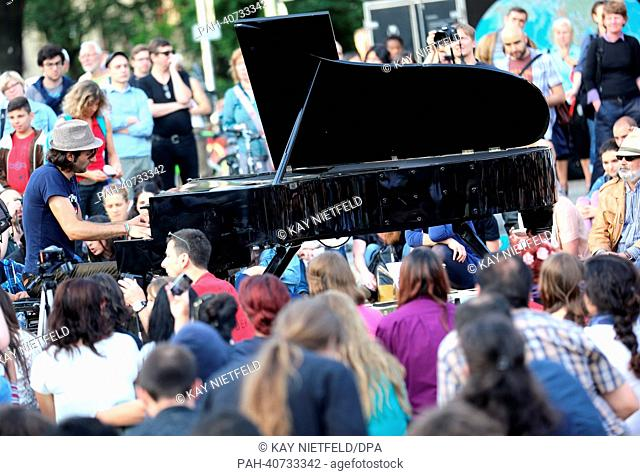 Davide Martello plays his piano to show solidarity with protesters in Turkey as part of a flashmob on Oranienplatz in Berlin,Germany, 02 July 2013