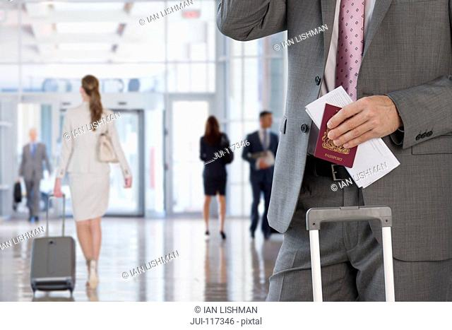 Detail Of Businessman At Airport With Luggage And Passport