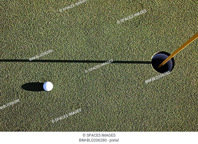 White Golf Ball Near the Cup