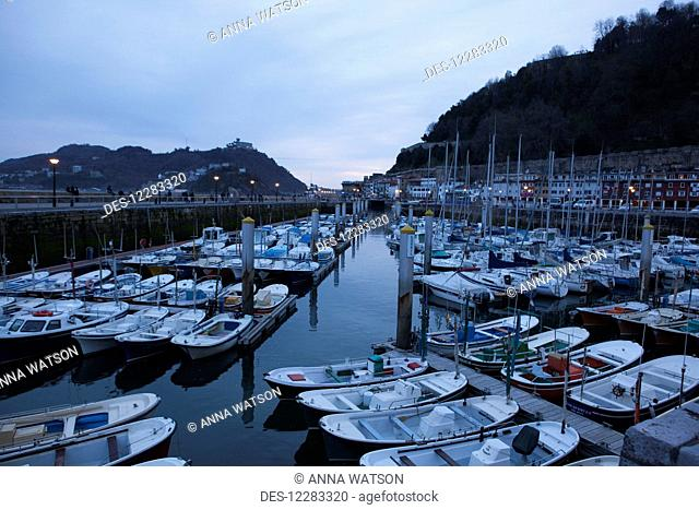 Boats in the harbour at dusk; San Sebastian, Spain