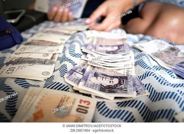Person counting money-UK pound sterling
