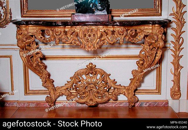 Console table (one of a pair). Maker: possibly by François Rournier (active 1716-46); Date: ca. 1735-40; Culture: French; Medium: Carved and gilded oak
