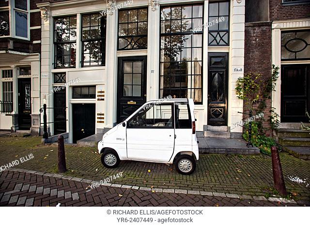 A Canta LX two-seat microcar created for disabled drivers parked along a street in Amsterdam