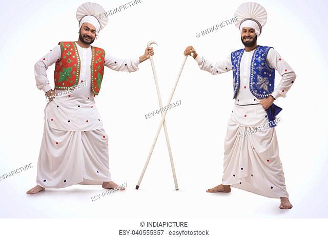 Sikh Man Holding With Khundis