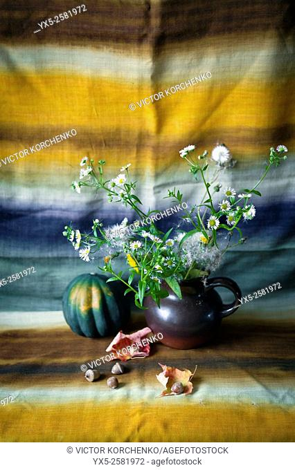 still life with flowers and acorns