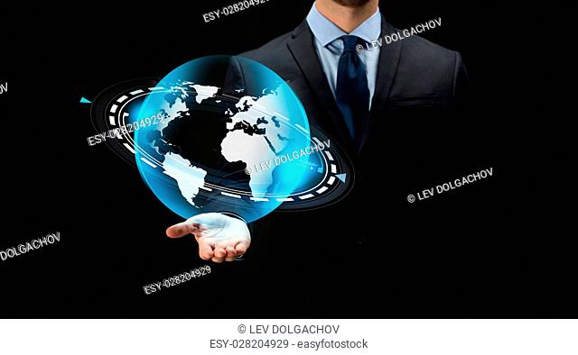 business, future technology, mass media, cyberspace and people - close up of businessman with virtual earth projection over black background