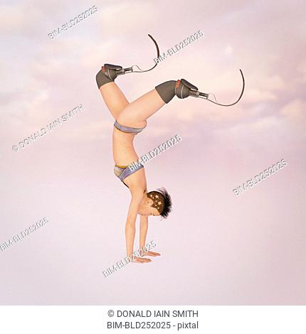 Woman with artificial legs performing handstand