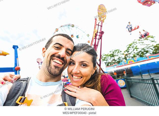 USA, New York, selfie of happy couple at Coney Island