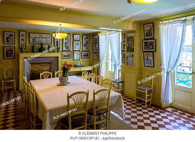 Yellow dining room in the house of Claude Monet, painter and founder of French Impressionist painting at Giverny, Eure department, Normandy, France