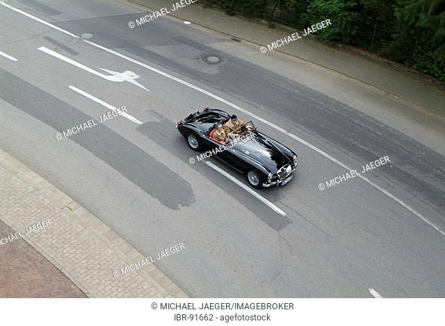 Black vintage car MG driving and from above
