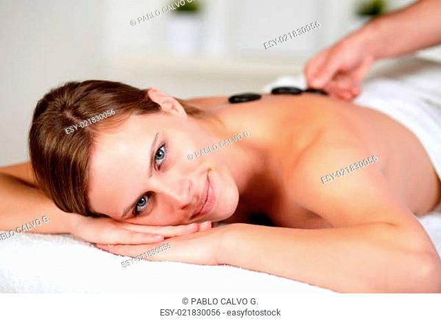 Relaxed female receiving a massage at spa