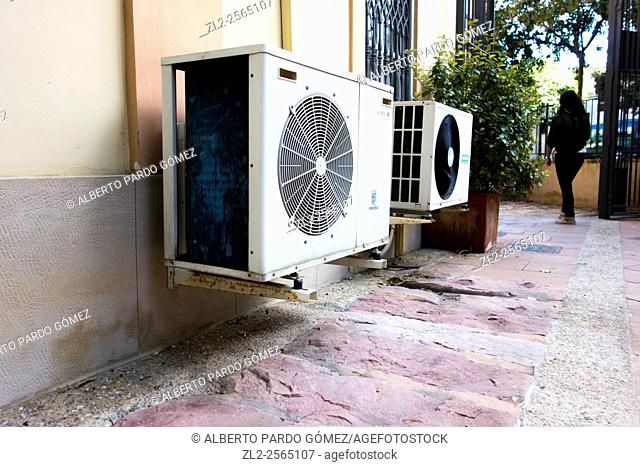 Air conditioning units in the facade of a house in Valencia, Spain