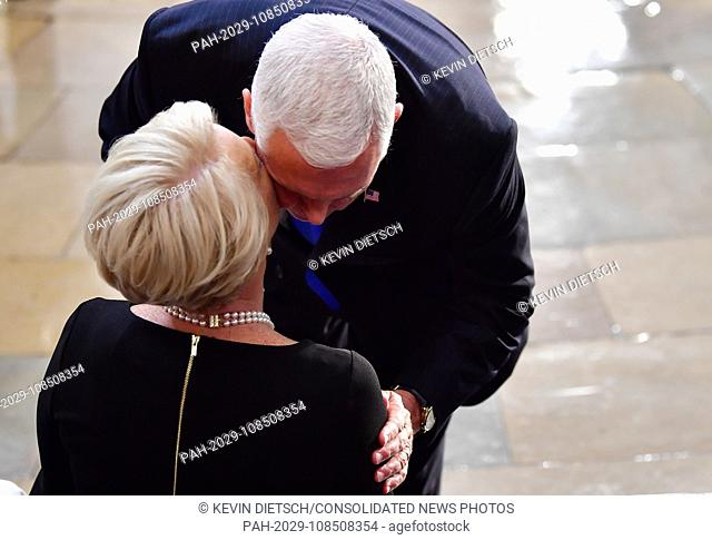 Vice President of the United States Mike Pence kisses Cindy McCain as the casket of former Senator John McCain in the Capitol Rotunda lies in state at the U