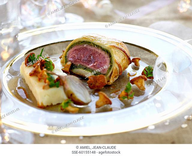 Beef fillet in pastry crust ,mashed potatoes and chanterelles