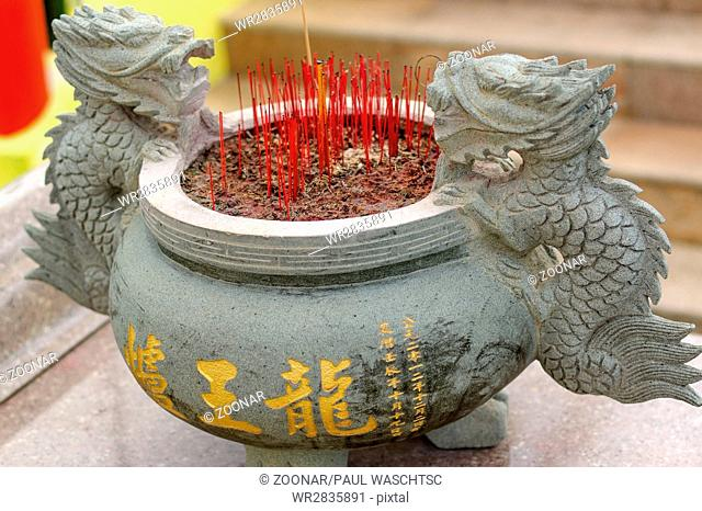 Burning Incense sticks in joss-stick pot in a chinese buddhism temple in Penang, Malaysia