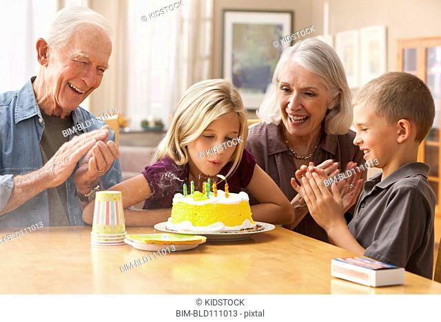 Caucasian family celebrating birthday