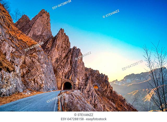 Alpi Apuane mountain road pass and double tunnel view at sunset. Carrara, Tuscany, Italy. Europe
