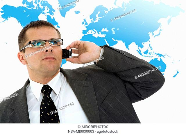 man with telephone in front of world map
