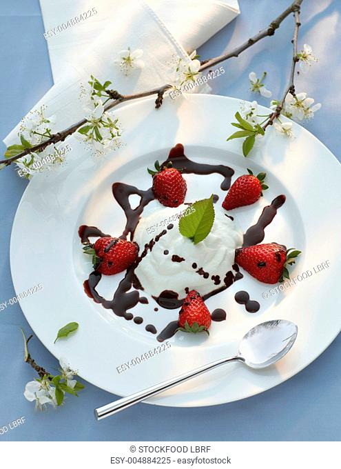 Cream goat's cheese with chocolate sauce and strawberries
