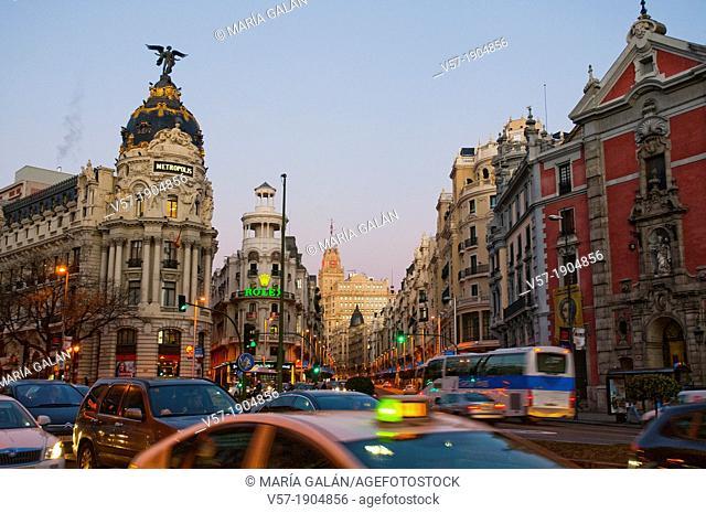 Traffic in Alcala street at dawn. Madrid, Spain