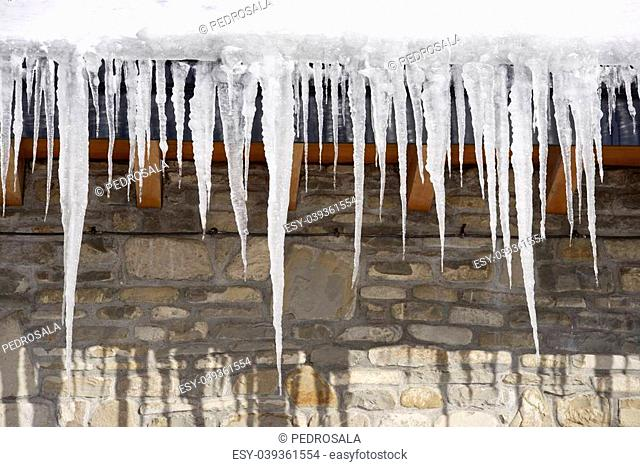 Icicles on the roof of a house in the Pyrenees, Canfranc Valley, Huesca, Aragon, Spain