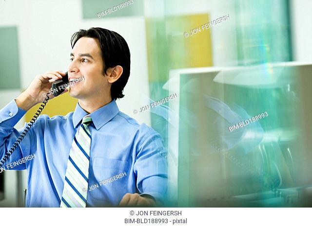 Hispanic businessman working in office