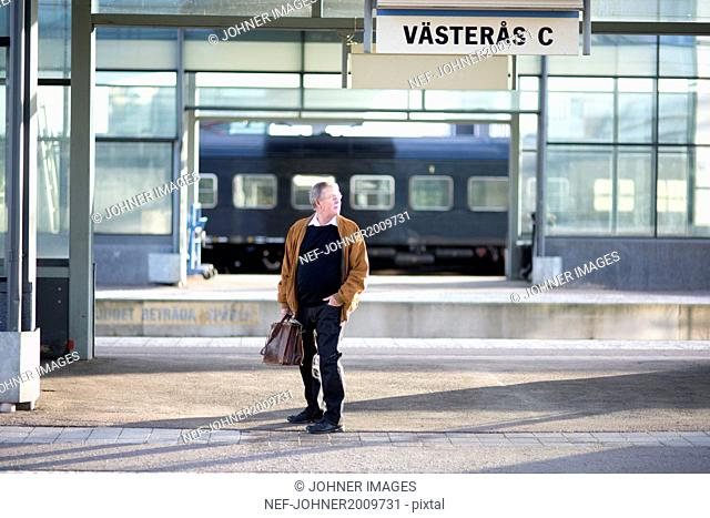 Senior man on train station