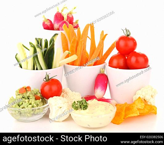 isolated vegetables anf dips on white