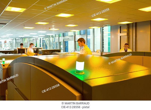 Workers using printers in printing plant