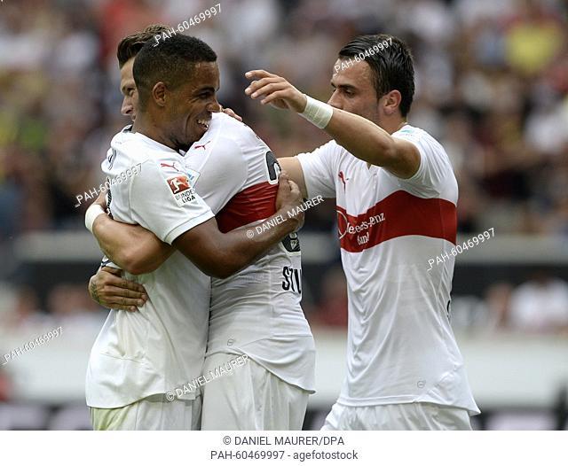 Stuttgart's Daniel Didavi (l-r), Daniel Ginczek and Filip Kostic celebrate their 3:0 victory in a friendly match between VfB Stuttgart and Manchester City at...