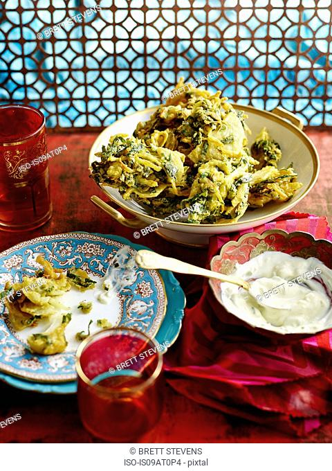 High angle view of onion bhajis and mint chutney