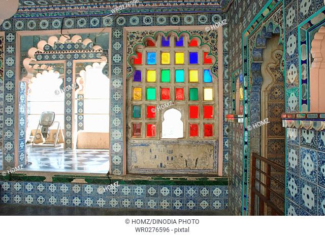 Section of Udaipur city palace Museum , Profusion of mirrors diffuses the sunlight , Udaipur , Rajasthan , India