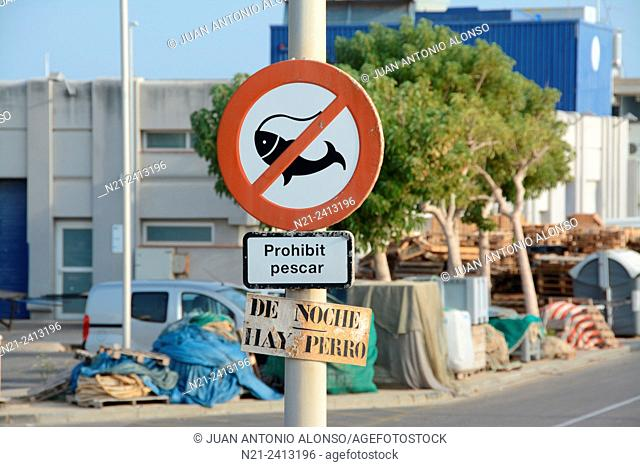 Fishing forbidden sign and a sign saying: 'There's a dog at night'. Cambrils, Tarragona, Catalonia, Spain, Europe