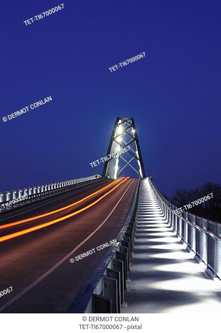 Illuminated bridge at dusk