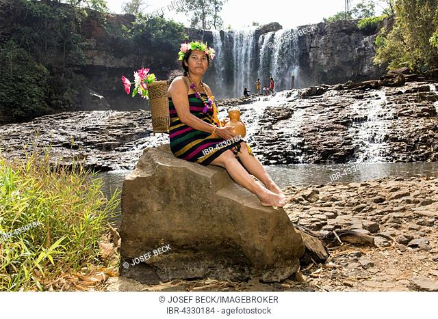 Phnong woman posing for tourists at the Bousra waterfall, Bunong, Bou Sra in Senmonorom, Sen Monorom, Mondulkiri Province, Cambodia