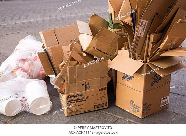 Cardboard Boxes and Plastic Bags on a City sidewalk ready to be picked up for Recycling, Old Montreal, Quebec, Canada